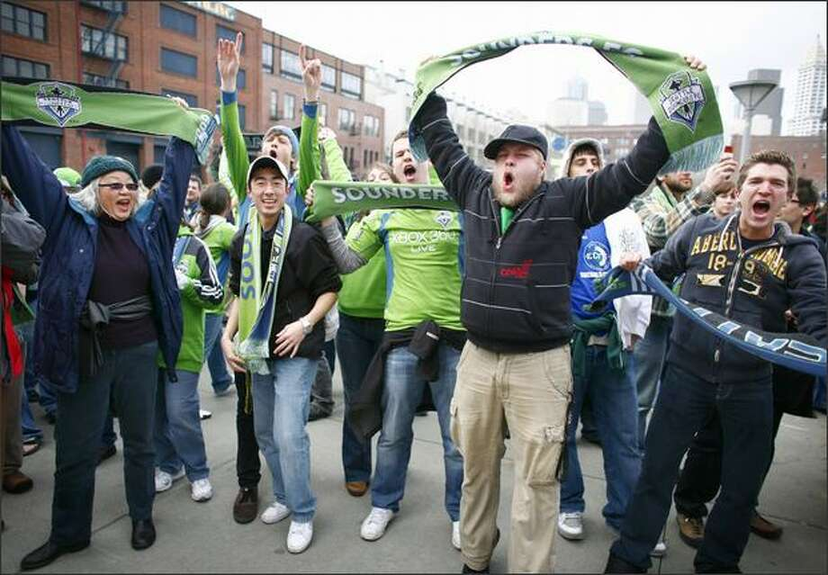 Rowdy fans cheer on their new Major League Soccer team, Sounders FC, before the team's season opener on Thursday, March 19, 2009 in Seattle. Photo: Joshua Trujillo/Seattle Post-Intelligencer