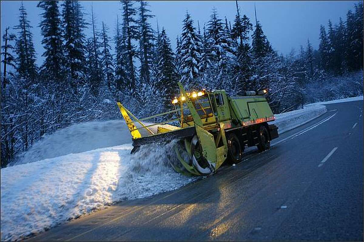 A snowblower clears the eastbound lanes of I-90 near exit 52 late Thursday afternoon.