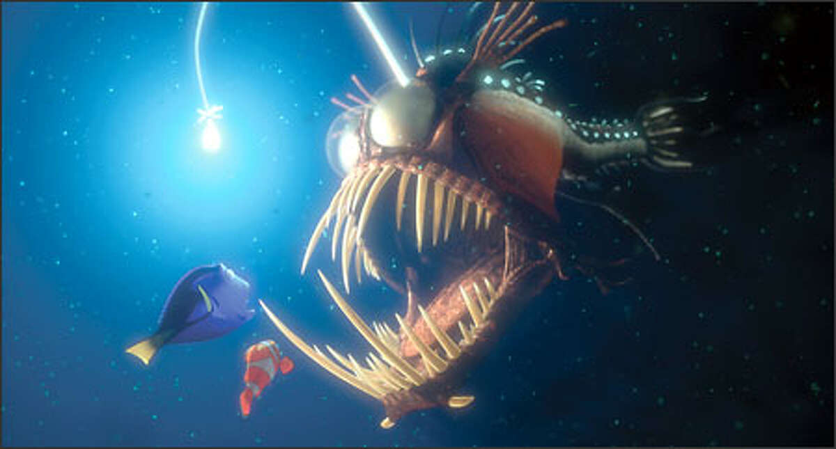 Dory (left), Marlin (center) encounter a mesmerizing light ... attached to a deadly angler fish (right).