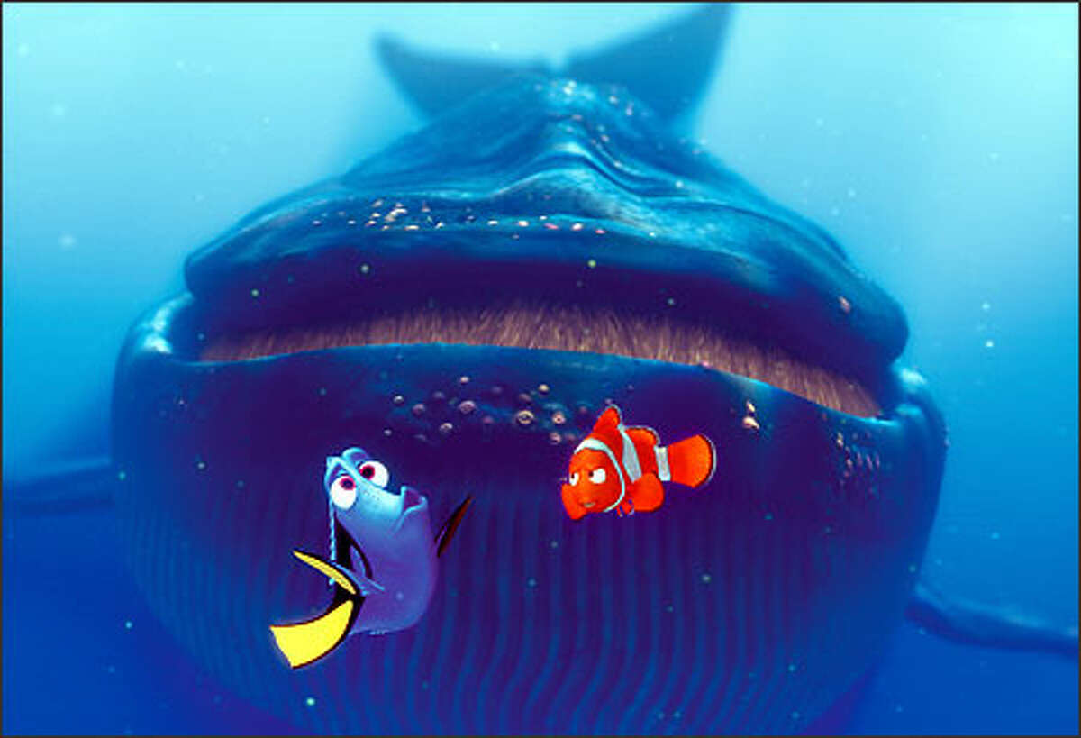 Dory (left) and Marlin (center) encounter a blue whale.