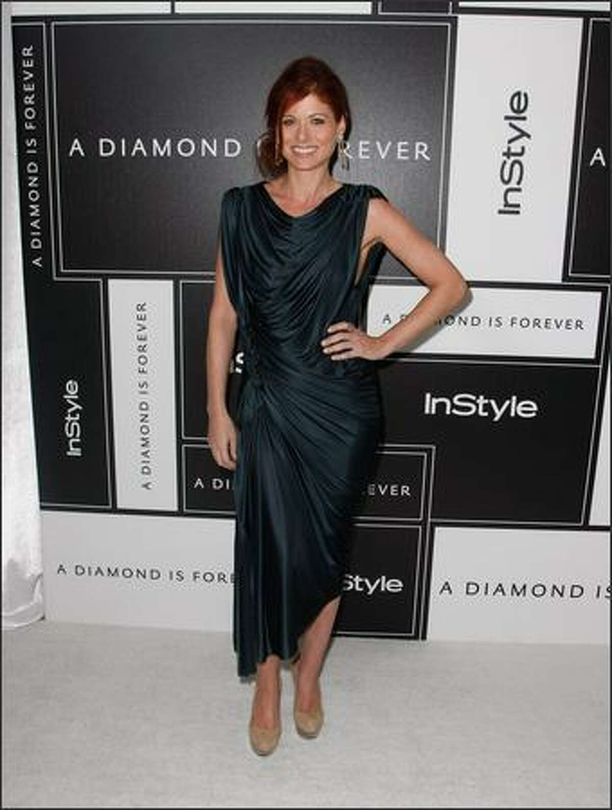 Actress Debra Messing attends the 8th Annual Awards Season Diamond Fashion Show Preview hosted by the Diamond Information Center and InStyle held at The Beverly Hills Hotel on Thursday in Beverly Hills, Calif.