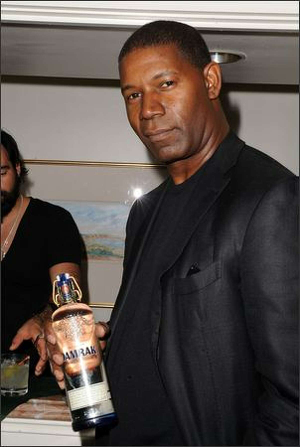 Actor Dennis Haysbert arrives at the Pre-Golden Globes DPA Gifting Lounge hosted by Nathalie Dubois held at the The Peninsula Hotel in Beverly Hills, Calif.