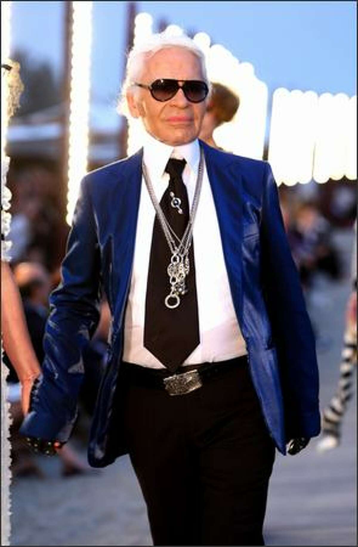 Designer Karl Lagerfeld walks the runway during the Chanel Cruise 2010 Fashion Show in Venice, Italy, on Thursday, May 14, 2009. Lagerfeld is the head designer at the venerable French couture house.