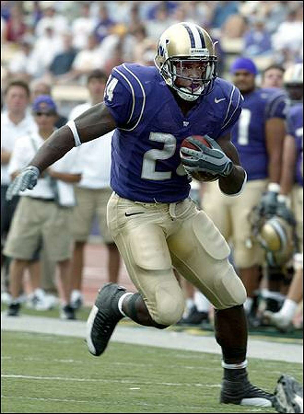 The UW's Rich Alexis runs down the sideline. He gained 74 yards on 18 carries against Indiana Saturday.