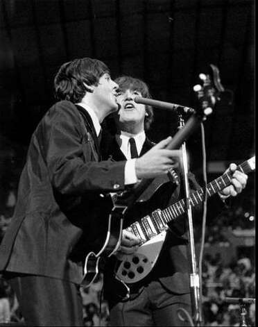 Paul McCartney and John Lennon at the Seattle Center Coliseum, Aug. 21, 1964. (Photo by Timothy Eagan/courtesy Mike Eagan)
