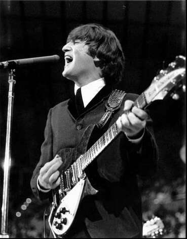 John Lennon, at the Seattle Center Coliseum, Aug. 21, 1964. (Photo by Timothy Eagan/courtsey of the Eagan family). Click here to read more about Eagan and the photos.