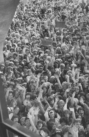 Fans waited outside the Seattle Center Coliseum before The Beatles Aug. 21, 1964 concert. Legendary disc jockey Pat O'Day said it was the first concert of its kind at what's now KeyArea. (Stuart B. Hertz/seattlepi.com file)