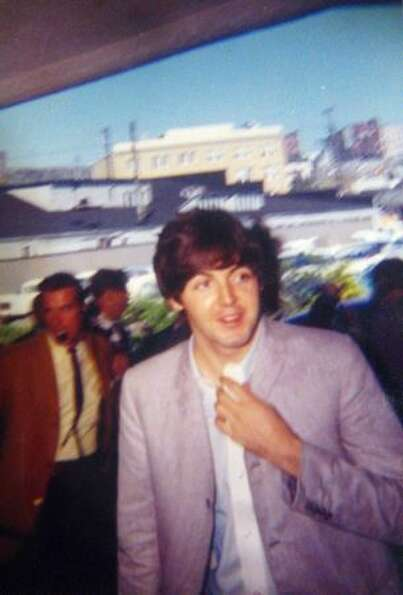 Paul McCartney arrives at the Edgewater Hotel. The photo is kept in a scrapbook made by Ann Wright,