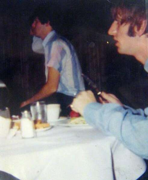 From left, Paul McCartney and Ringo Starr have a meal at the Edgewater Hotel. The dishes The Beatles