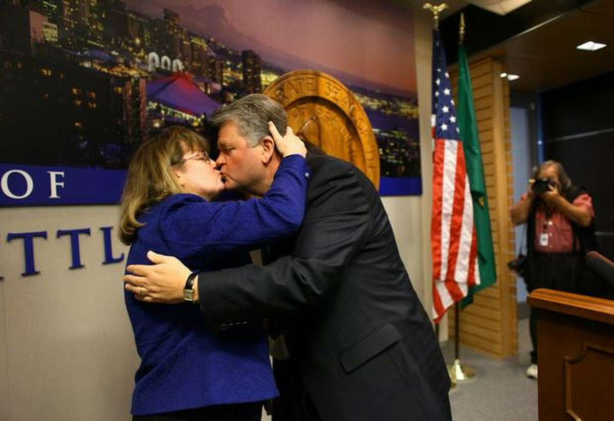 Seattle Mayor Greg Nickels kisses his wife, Sharon, after he concedes defeat during a press conference in the Mayor's Office.