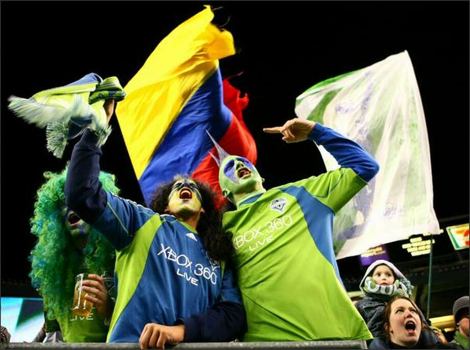 "From left, Jordan McDonald, Elston Cloy and ""Mr. Mohawk"" cheer as the Sounders score their second goal. Photo: Joshua Trujillo/seattlepi.com"