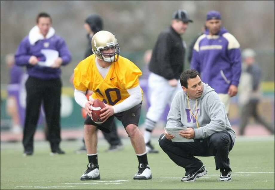 Jake Locker and Steve Sarkisian talk strategy during the Huskies' first season practice. Photo: Clifford DesPeaux/seattlepi.com