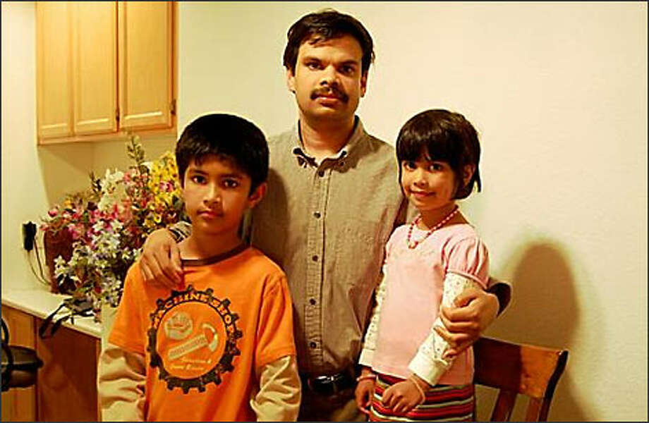 Devan Kalathat poses with his son, Akhil Dev, and daughter, Neha Dev, in a photo from January on Kalathat's Flickr page.