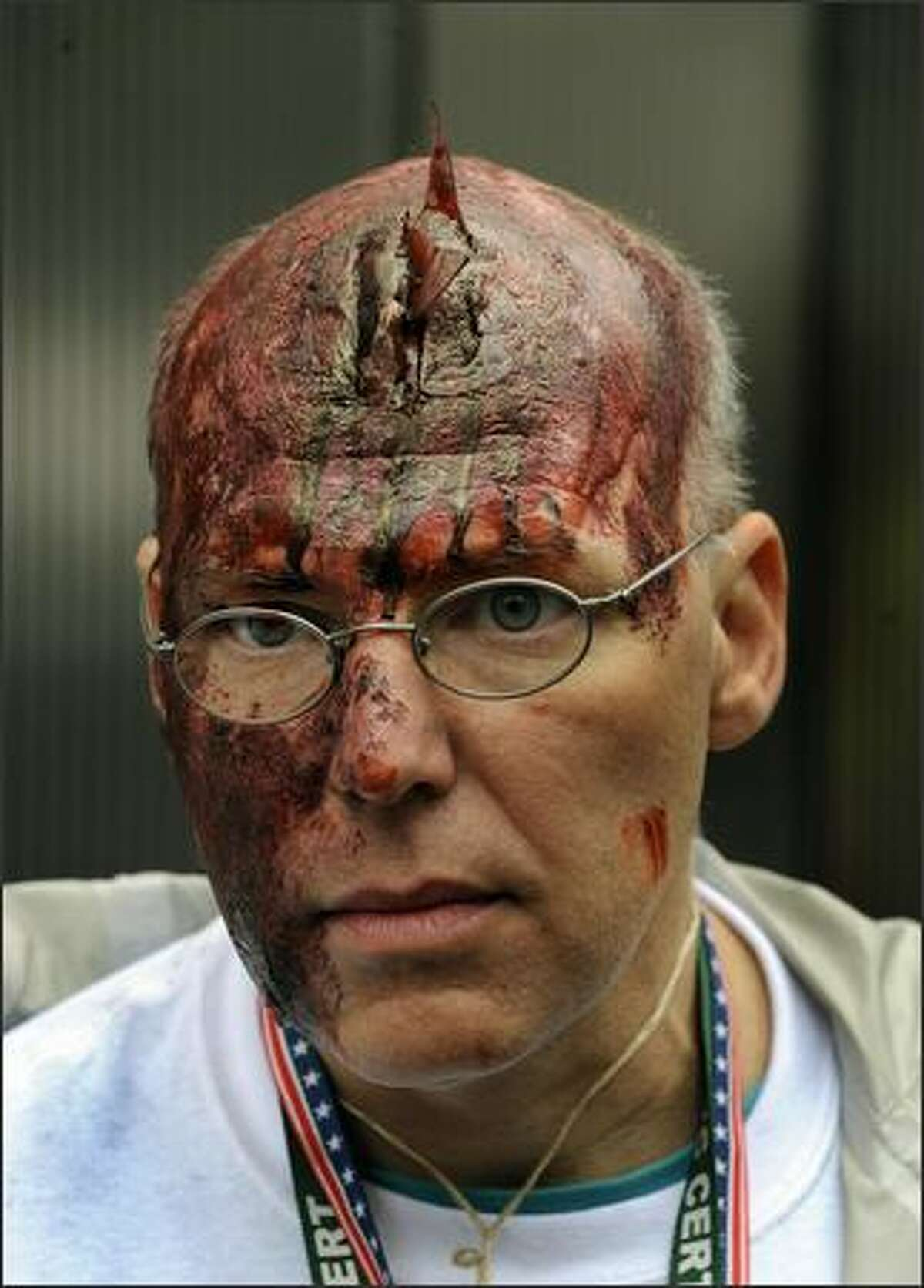 A volunter victim with a fake shard of glass in his head is seen during Operation Safe PATH 2009 Sunday at the PATH station at the World Trade Center. Hundreds of firefighters and police swarmed Ground Zero Sunday, the site where the World Trade Center once stood, in the largest security exercise here since the Sept. 11, 2001 attacks. As part of an elaborate dress rehearsal for a possible future terror strike, rescue workers exploded simulated bombs in a commuter train tunnel linking Manhattan to New Jersey burrowed beneath the Hudson River.