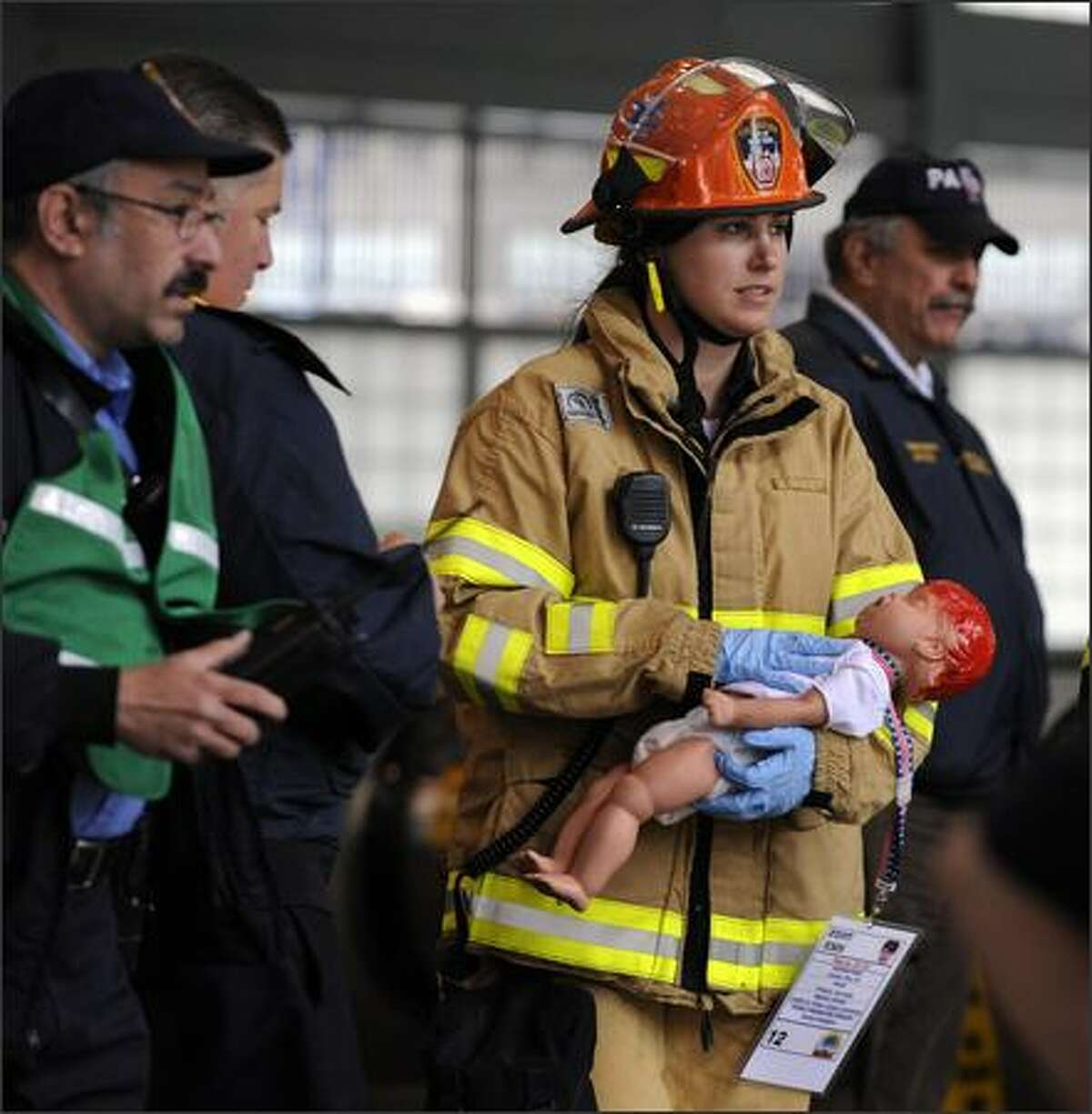 A New York City Fire Department EMS worker carries a dummy baby victim during Operation Safe PATH 2009 Sunday at the PATH station at the World Trade Center. Hundreds of firefighters and police swarmed Ground Zero Sunday, the site where the World Trade Center once stood, in the largest security exercise here since the Sept. 11, 2001 attacks. As part of an elaborate dress rehearsal for a possible future terror strike, rescue workers exploded simulated bombs in a commuter train tunnel linking Manhattan to New Jersey burrowed beneath the Hudson River.