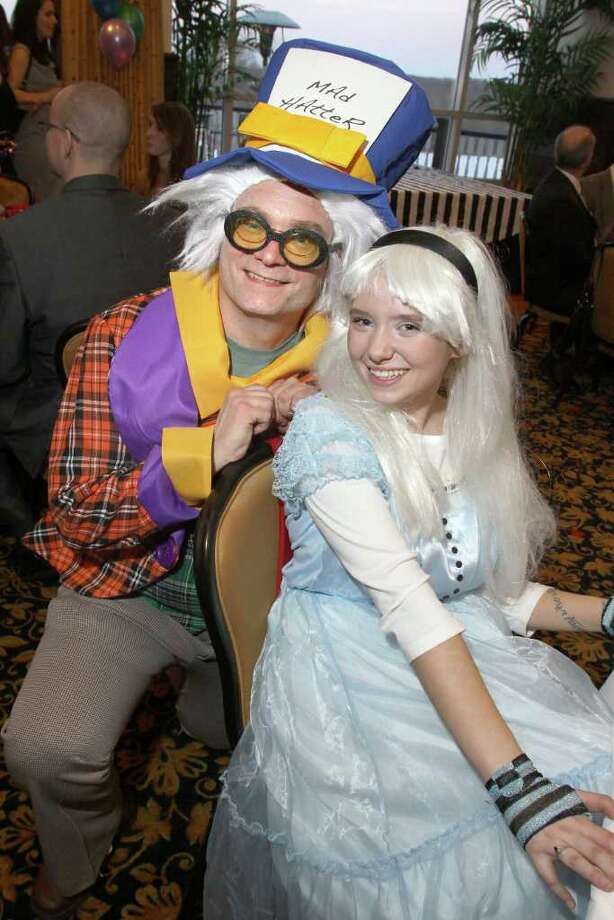 "Dan Busha and Laura Henebry channel the Mad Hatter and Alice in Wonderland during ""An Evening with the Mad Hatter,"" an ""Alice in Wonderland""-themed gala to benefit The Children?s Museum on March 19, 2011, in Saratoga Springs. (Photo by Joe Putrock / Special to the Times Union) Photo: Joe Putrock / Joe Putrock"