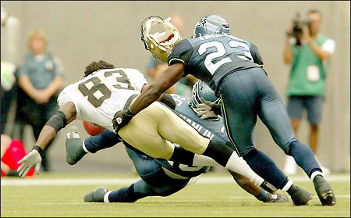 Seahawks rookie Ken Hamlin delivers the crunching hit that knocked the helmet off Saints wideout Donte' Stallworth, with fellow rookie Marcus Trufant close behind.