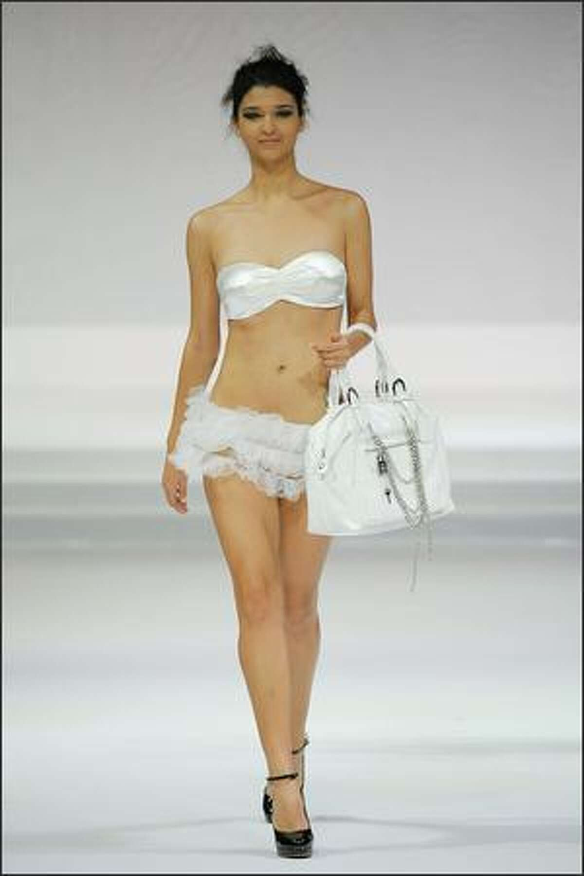 A model showcases designs by CROWN as part of the Taipei In Style Fashion show on the catwalk as part of Hong Kong Fashion Week Fall/Winter 2009 at the Hong Kong Convention and Exhibition Centre on Tuesday in Hong Kong.