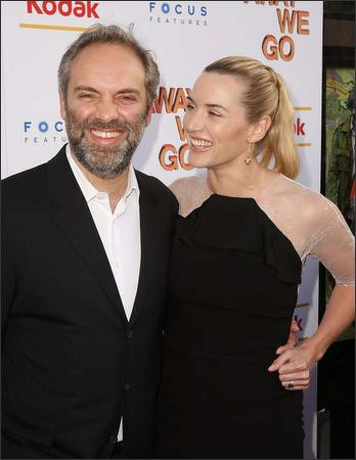 Director Sam Mendes and wife actress Kate Winslet attend a special New York screening of