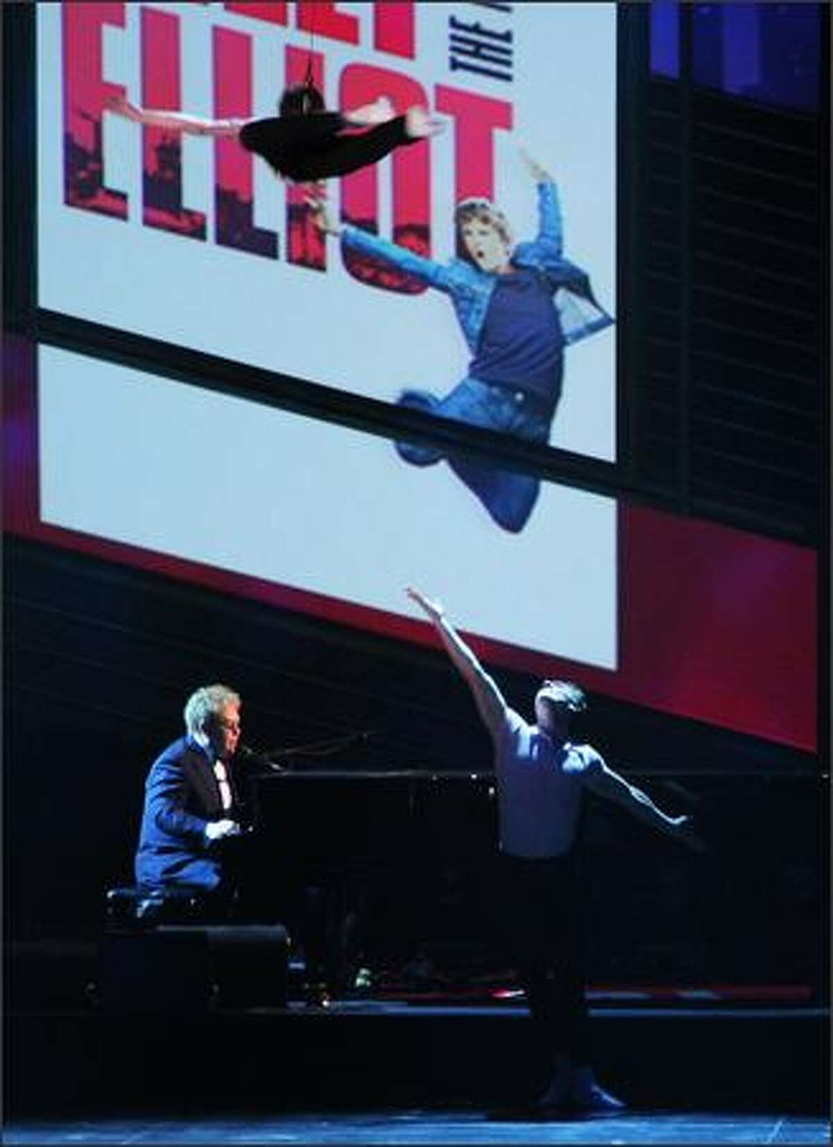 Musician Elton John performs a song from