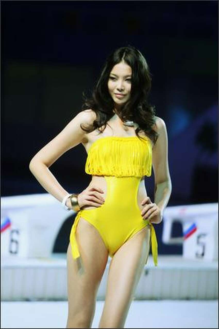 A model walks on the runway during 2009 HOSA CUP, the 6th China Swimming Wear Design Contest at the National Aquatics Center, known as the Water Cube, in Beijing, China.