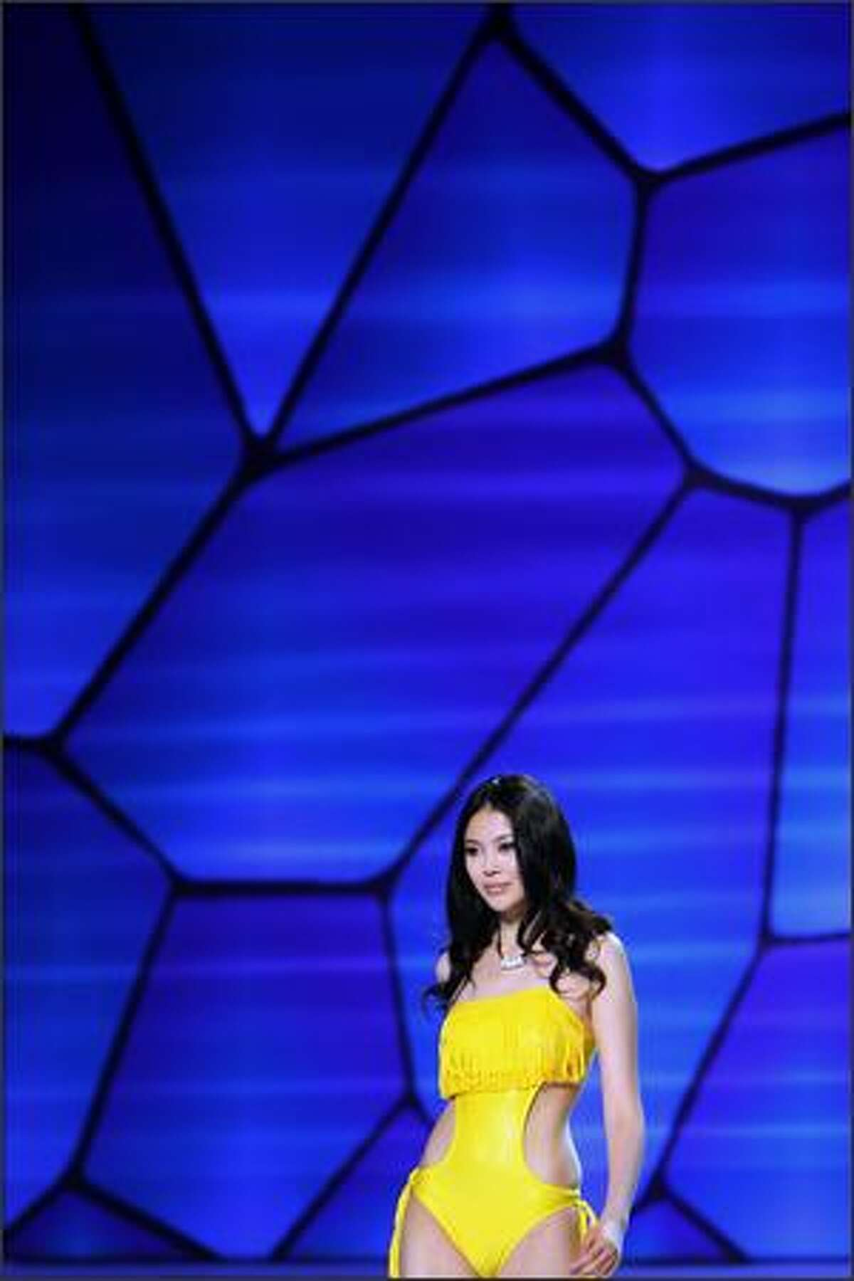 A model walks on the runway during 2009 HOSA CUP, the 6th China Swimming Wear Design Contest at the National Aquatics Center, known as the Water Cube in Beijing, China.