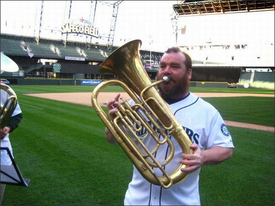 Tuba player Greg Powers practices Thursday night at Safeco Field. Photo: Casey McNerthney/seattlepi.com