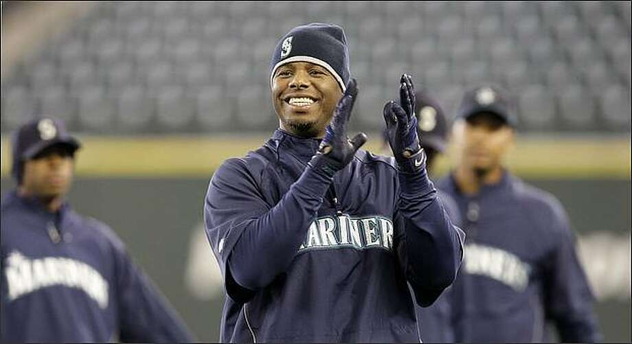 Seattle Mariners' Ken Griffey Jr. claps as he begins a workout Monday at Safeco Field. The Mariners open their home season Tuesday against the Los Angeles Angels. (AP Photo/Elaine Thompson) Photo: / Associated Press