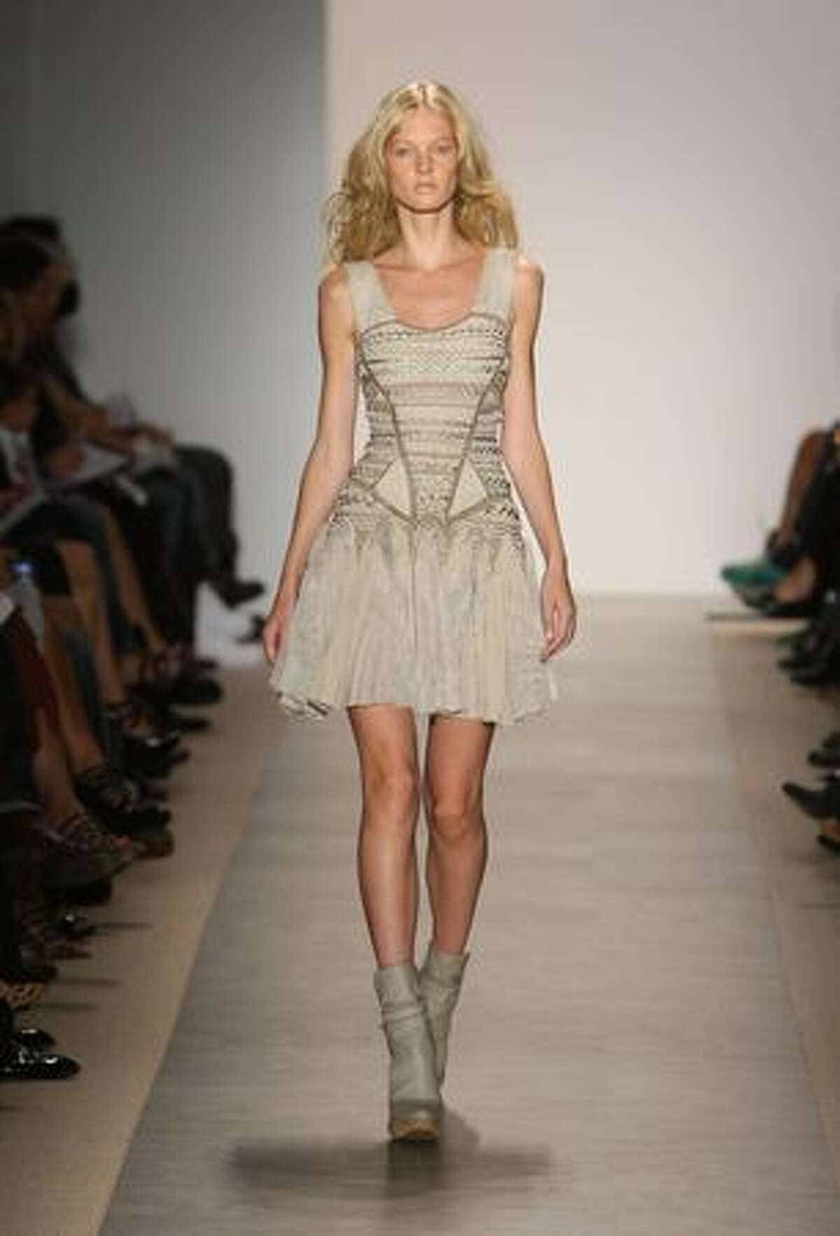 A model walks the runway during the the Herve Leger Spring 2010 Fashion Show at the Promenade at Bryant Park on Sunday in New York City.