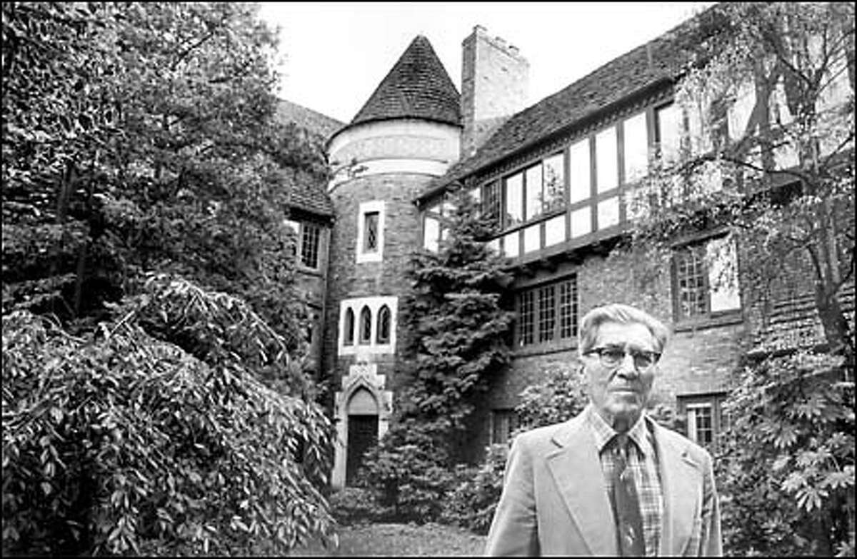 From the P-I archives: Fred Anhalt's apartments on Capitol Hill were inspired by Norman and Tudor designs. Several of his buildings are considered landmarks on the hill, and most are still in use. Anhalt, who died in 1996, is shown here in the courtyard of his building at 1005 E. Roy St. in 1982.