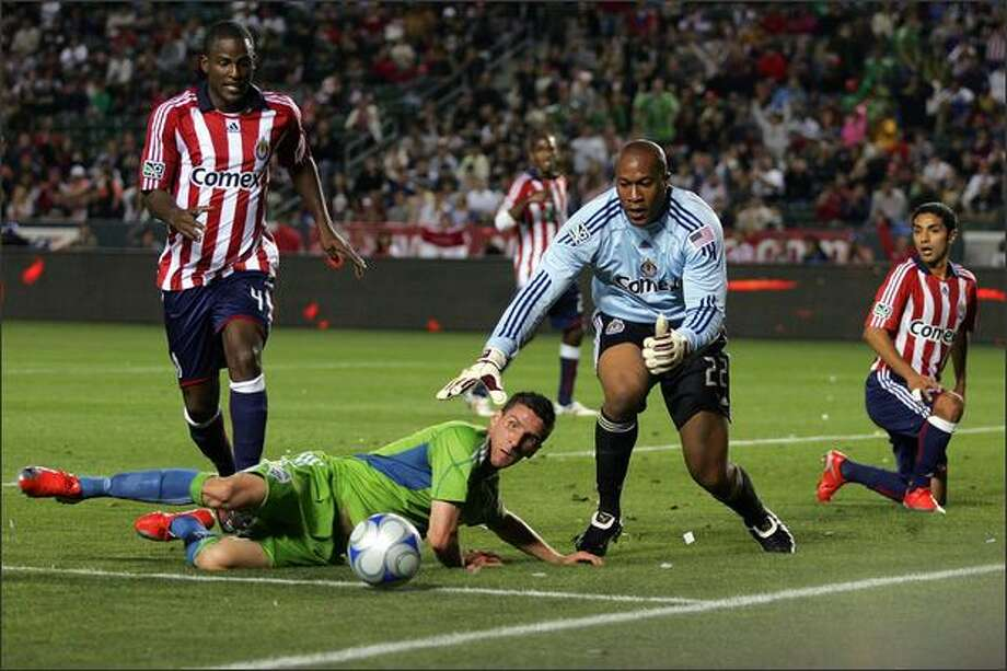 Sebastien LeToux of Seattle Sounders FC looks to play the ball to the goal as goalkeeper Zach Thornton of Chivas USA defends LeToux's scoring attempt in the first half. (Photo by Victor Decolongon/Getty Images) Photo: / Getty Images