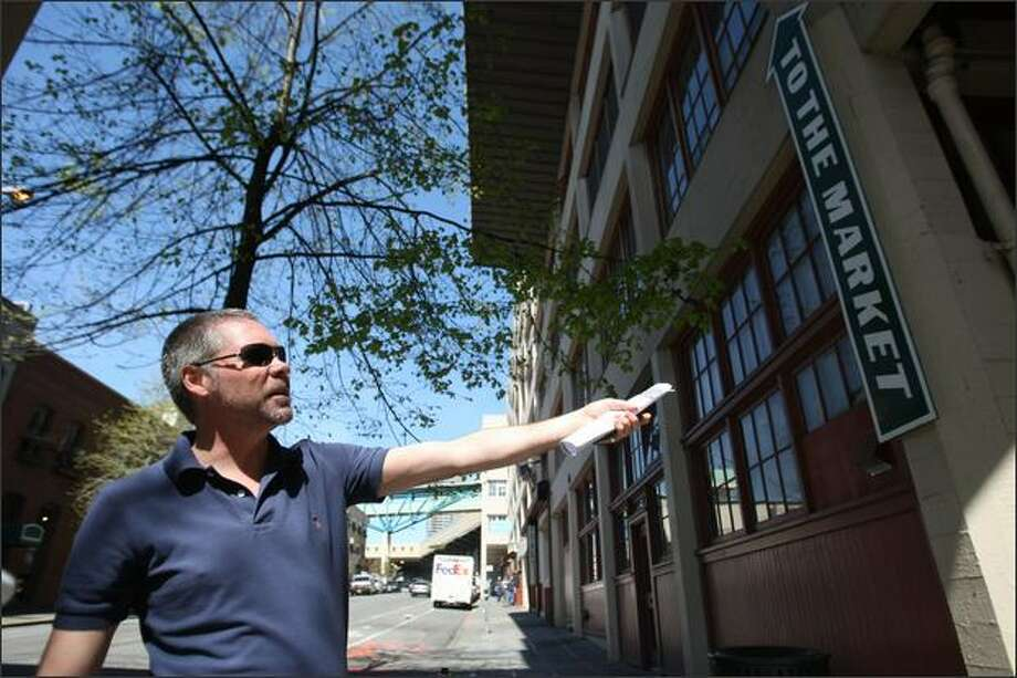 Director of Marketing and Communications James Haydu points toward the Pike Place Market Hillclimb, which will be renovated to include an elevator. Photo: Clifford DesPeaux/seattlepi.com