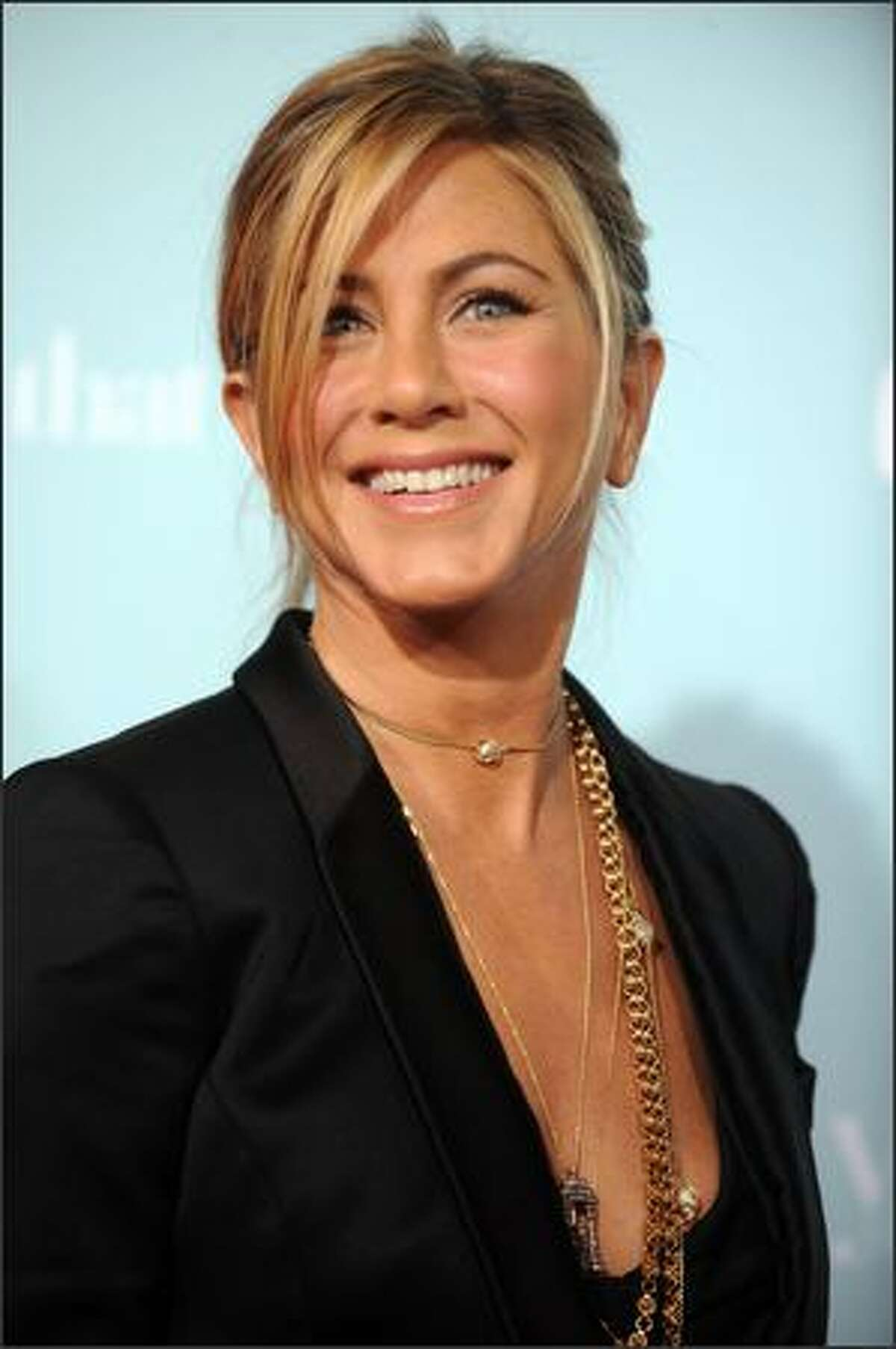 """Actress Jennifer Aniston arrives for the World premiere of """"He's Just Not That Into You"""" at the Grauman's Chinese Theatre in Los Angeles on Tuesday."""