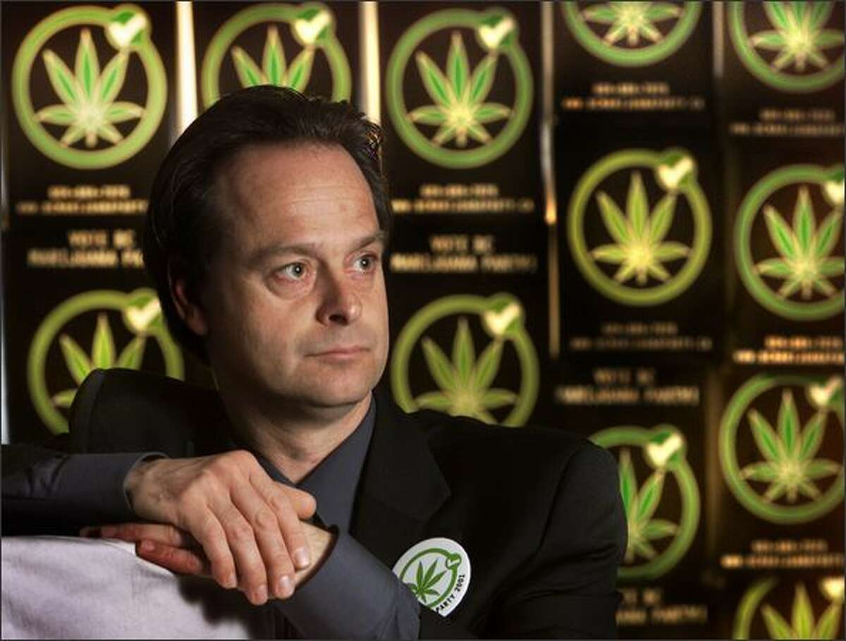 Marijuana Party President Marc Emery stands in the party's campaign headquarters in downtown Vancouver, B.C., in this photo taken May 7, 2001.