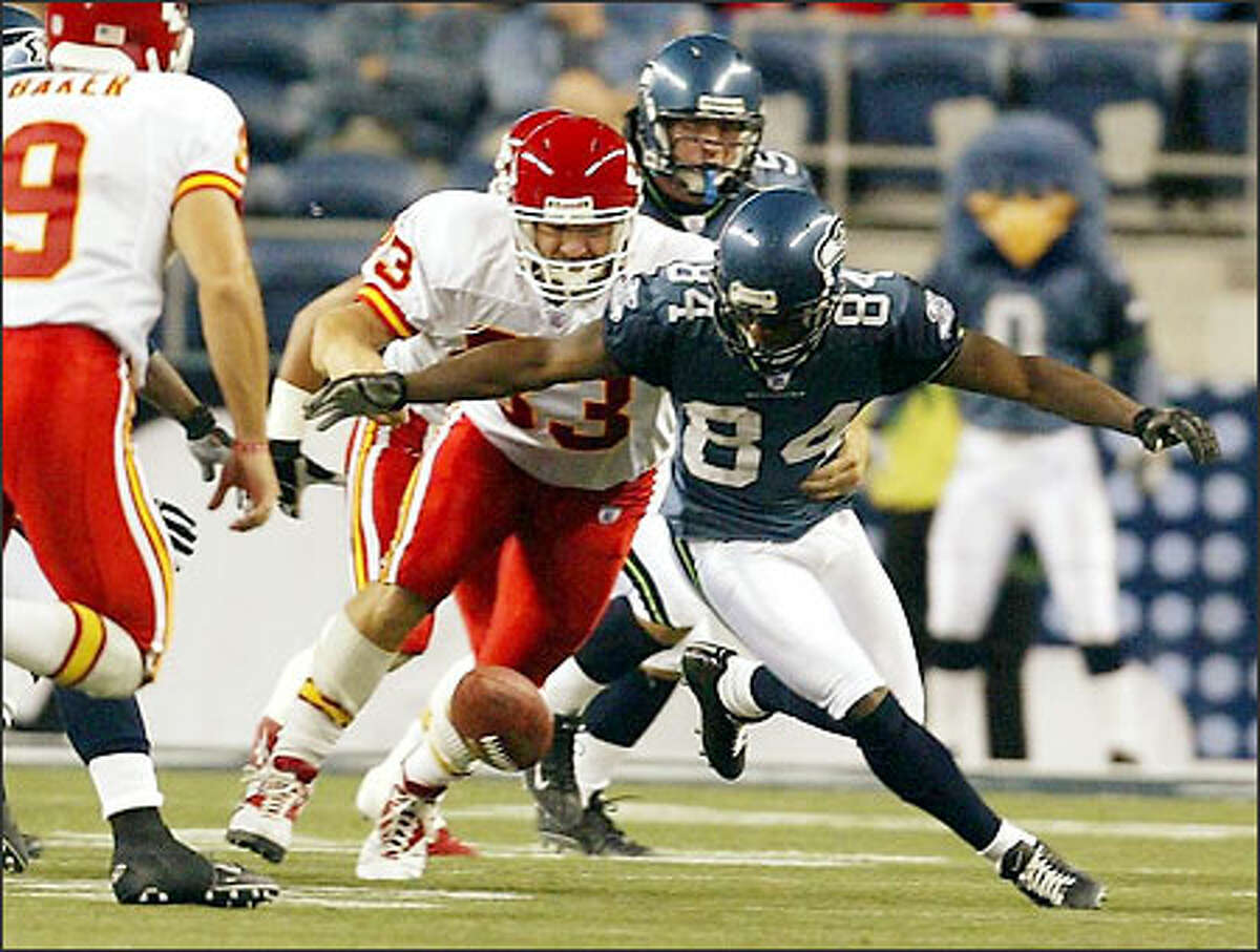 Seahawks Bobby Engram fumbles a 51 yard punt from the Chiefs after gaining 17 yards during thrid quarter.