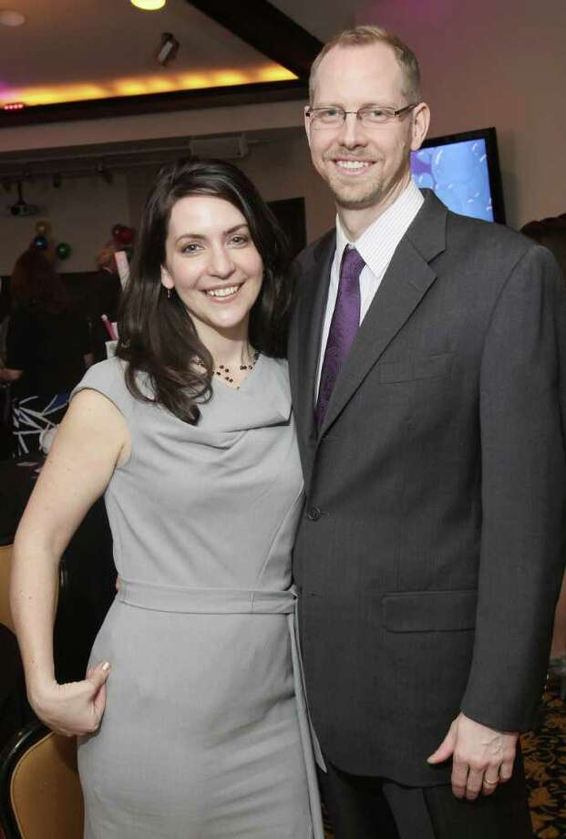 Shelby Schneider, a former board member at the Children's Museum, and her husband, Evan, attend a benefit March 19, 2011,  in Saratoga Springs. (Photo by Joe Putrock / Special to the Times Union) Photo: Joe Putrock / Joe Putrock