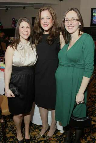 "Julie Fariello, Carin Perkins and Sarah Miczek during ""An Evening with the Mad Hatter,"" an ""Alice in Wonderland""-themed gala to benefit The Children's Museum on March 19, 2011, in Saratoga Springs. (Photo by Joe Putrock / Special to the Times Union) Photo: Joe Putrock / Joe Putrock"