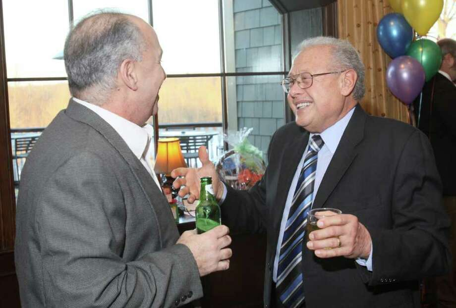 "Nick Perrotta (left) talks with Nick Palmetto (right), who had donated the space for the original children's museum, during ""An Evening with the Mad Hatter,"" an ""Alice in Wonderland""-themed gala to benefit The Children's Museum on March 19, 2011, in Saratoga Springs. (Photo by Joe Putrock / Special to the Times Union) Photo: Joe Putrock / Joe Putrock"