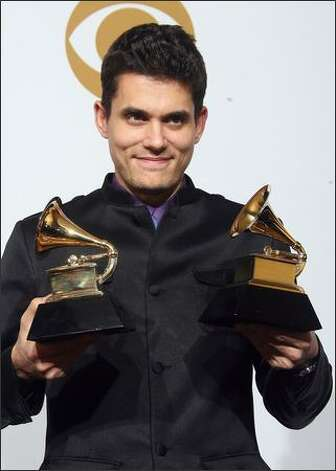 Singer John Mayer holds the Grammy awards for the Best Male Pop Vocal Performance and Best Solo Rock Vocal Performance. Photo: Getty Images
