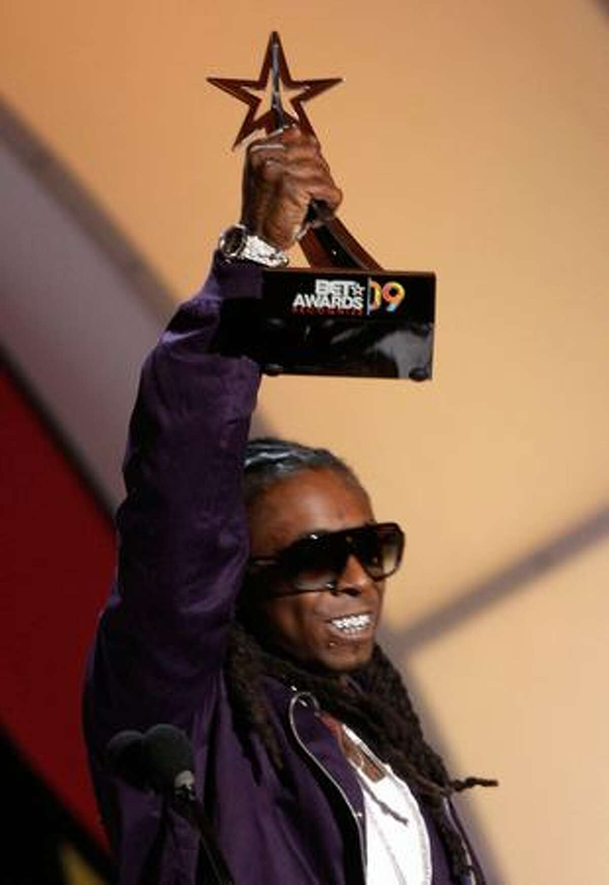 Rapper Lil' Wayne accepts the Best Male Hip-Hop Artist award on stage during the 2009 BET Awards held at the Shrine Auditorium on Sunday in Los Angeles, California.