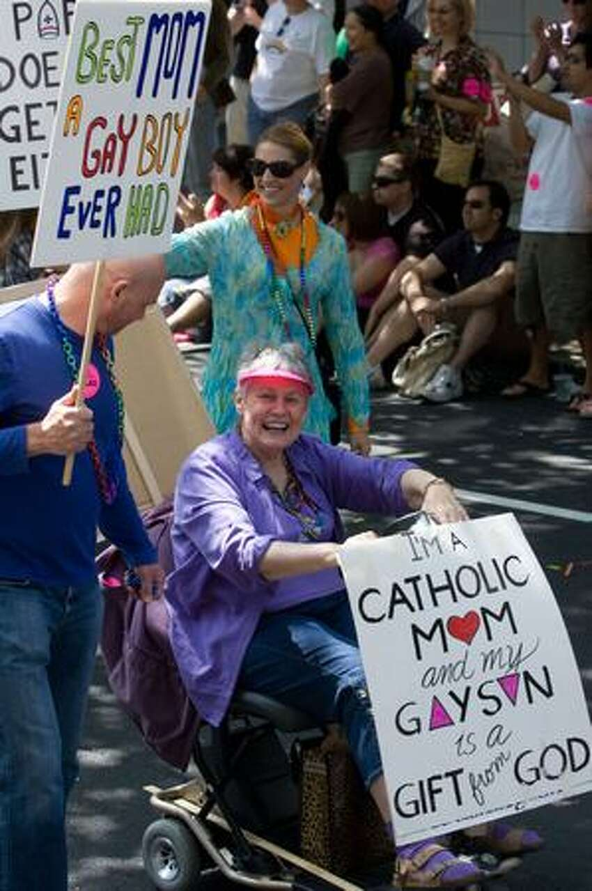 A participant lets her views be known during the Seattle Pride Parade.