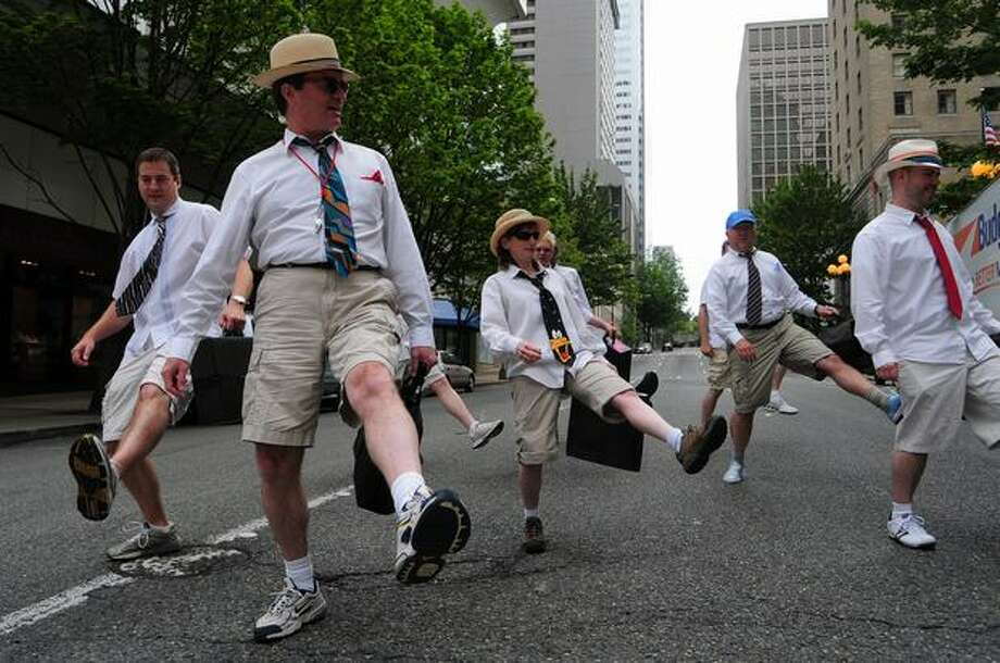 Members of the Greater Seattle Business Association practice their routine before the start of the parade. Photo: Daniel Berman, Seattlepi.com