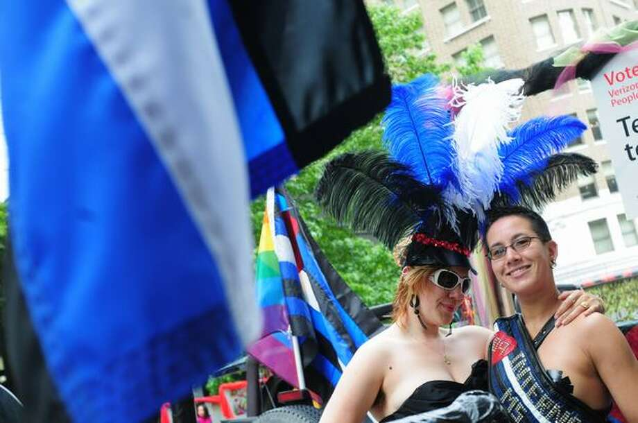 Honeysuckle Hype and her friend Lamalani Siverts (right) hang out and relax before the start of the parade. Photo: Daniel Berman, Seattlepi.com