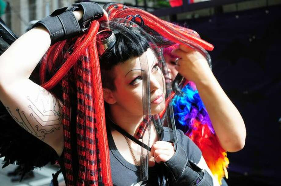 Orpheus Faust of Tilted Thunder Railbirds gets some help with her costume from Paisley Parker of the Seattle Derby Brats. Photo: Daniel Berman, Seattlepi.com