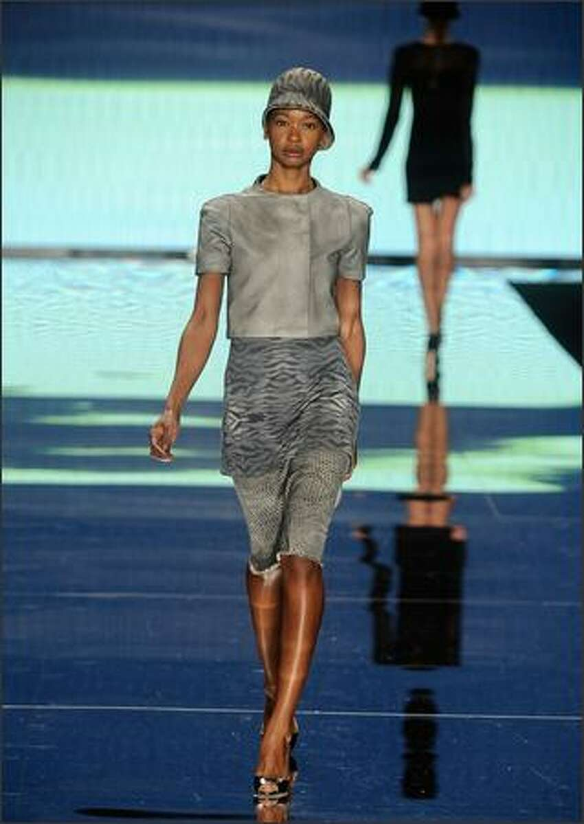 A model walks the runway at the This Day/Arise Magazine: African Fashion Collective show.