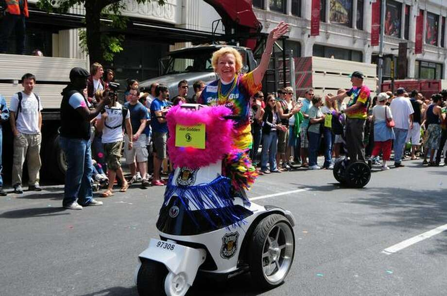 Seattle City Council member Jean Godden waves from a police scooter. Photo: Daniel Berman, Seattlepi.com