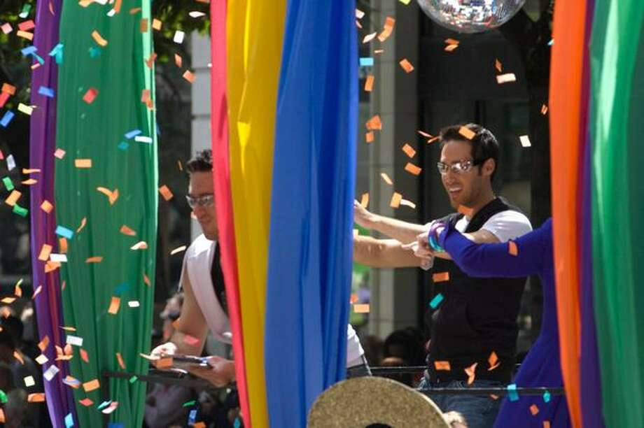 "Confetti is released off the ""Peace, Love and Equality"" float during the Seattle Pride Parade. Photo: Daniel Berman, Seattlepi.com"