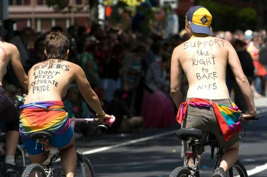 Bicyclists make their case during the Seattle Pride Parade. Photo: Daniel Berman, Seattlepi.com