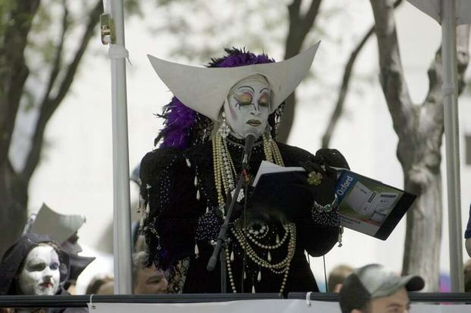A costumed announcer makes a comment during the Seattle Pride. Photo: Daniel Berman, Seattlepi.com
