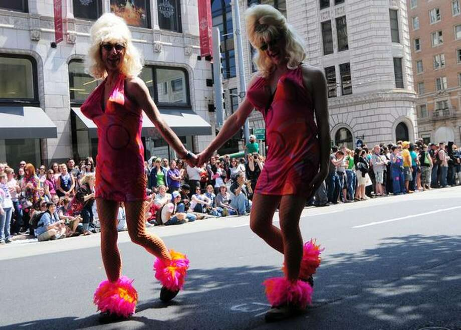 Twin participants make their way during the Seattle Pride Parade. Photo: Daniel Berman, Seattlepi.com